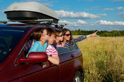 Car trip on family vacation. Happy parents and kids travel and have fun, car insurance concept royalty free stock images