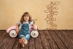 Car trip. Happy child playing at home. Car trip. Summer vacation and travel concept Royalty Free Stock Photo