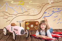 Car trip. Happy child playing at home. Car trip. Summer vacation and travel concept Stock Photo