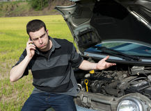 Car trouble. Sad man in trouble with his car , calling the repair service Royalty Free Stock Photo