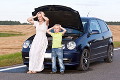 Car trouble. Young mother with two children having car trouble Royalty Free Stock Image