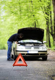 Car trouble. Man trying to repair the car Royalty Free Stock Photo