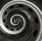 Car truck wheel abstract spiral fractal pattern background. Repetitive automobile automotive spiral background. Car wheel abstract Stock Photography