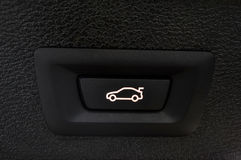 Car trunk closing button. Royalty Free Stock Photo