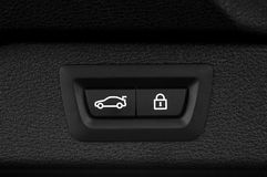 Car trunk closing button. Auto detail interior Stock Images