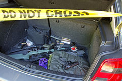 Car trunk full of guns. Evidence style photo of a car trunk full of guns and ammunition Royalty Free Stock Photo