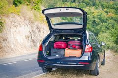 Car with trunk loaded with suitcases. And luggage Royalty Free Stock Photos