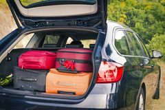 Car with trunk loaded with suitcases. And luggage Royalty Free Stock Photography