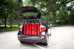 Car Trunk with Luggage. Hatchback car trunke with 3 big luggage Royalty Free Stock Images