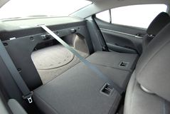 Car trunk with rear seats folded. The boot in the sedan inside with folded rear seats Stock Photo