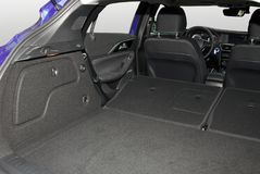 Car trunk with rear seats folded. Empty trunk of the smallblue suv Royalty Free Stock Photo