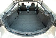 Car trunk with rear seats folded. A large car trunk with folded rear seats Royalty Free Stock Photography