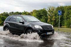 Car trying to drive against flood on the street in Gdansk, Poland. Royalty Free Stock Image