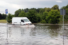 Car trying to drive against flood on the street in Gdansk, Poland. Stock Image