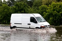 Car trying to drive against flood on the street in Gdansk, Poland. Royalty Free Stock Photography