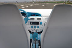 Car tuning. Interior. Tuning the car, look at the control panel from the back Royalty Free Stock Image