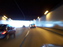 Car tunnel 1. End of tunnel trip with car; scene is blurred; odd viewing royalty free stock photo