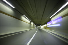 Car in Tunnel. Panning with camera attached on the car Stock Photo