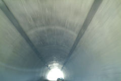 Car in Tunnel. Car travelling down a tunnel.  Blurred effect shows motion Stock Images