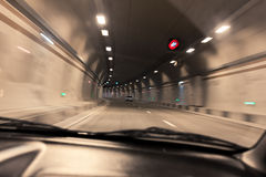 Car in the tunnel. Blurred motion monochrome picture of cars in a highway tunnel Royalty Free Stock Images