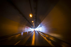 Car in a tunnel on the highway Stock Images