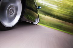 Car in turn. Wonderful side shot of car in blurred motion Stock Image