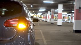 Car turn on indicator light signal. Car in underground parking with emergency stock footage