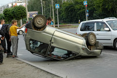 Car turned upside-down after road collision Royalty Free Stock Photo