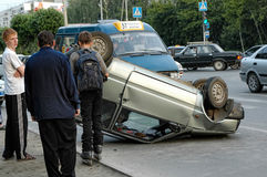 Car turned upside-down after road collision Royalty Free Stock Photography