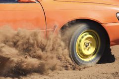 Car turning on dirt road Stock Image