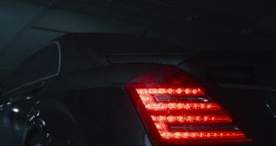 Car turning lights is on. Flashing orange blinker light on rear lamp before car get a move stock video