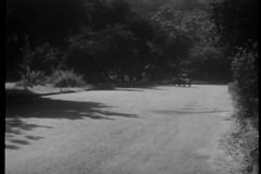 Car turning off country road to hide from police, 1940s stock video
