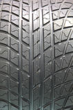A car tyre. Closeup texture of a car tyre Stock Images