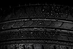 Car tyre on a black background royalty free stock images