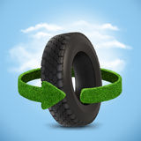 Car tyre. Concept with green arrows from the grass. Recycling concept Stock Image