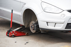 Car during Tyre replacement. Passenger car during mobile winter tyre fitting replacement Stock Photography