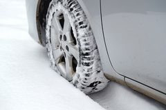 Car tyre in snow royalty free stock photo