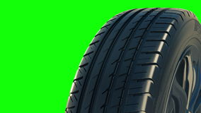 Car tyre summer wheel rotate motion isolate green stock video footage