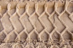 Car tyre traces on sand background Royalty Free Stock Images