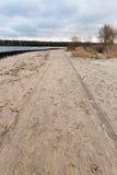 Car tyre tracks on the beach sand Stock Photo