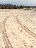 Car tyre tracks on the beach sand Stock Photos