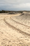 Car tyre tracks on the beach sand Stock Photography