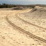 Car tyre tracks on the beach sand Stock Photography
