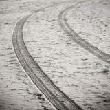 Car tyre tracks on the beach sand - retro vintage look Royalty Free Stock Photo