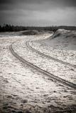 Car tyre tracks on the beach sand - retro vintage look Stock Photography