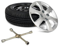 Car tyre with wheel cap and screwdriver Royalty Free Stock Photos