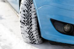 Car tyre in winter covered with snow.On road with fresh snow. close up.  stock photo