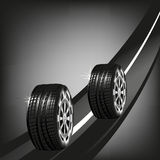 Car tyres on the road isolated on black background Stock Photography
