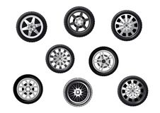 Car tyres set. Collection of wheels or tyres with spoked alloy rims and hubs, isolated on white Royalty Free Stock Images