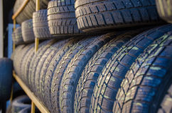 Car tyres. Some car tyres on a shelf Stock Images